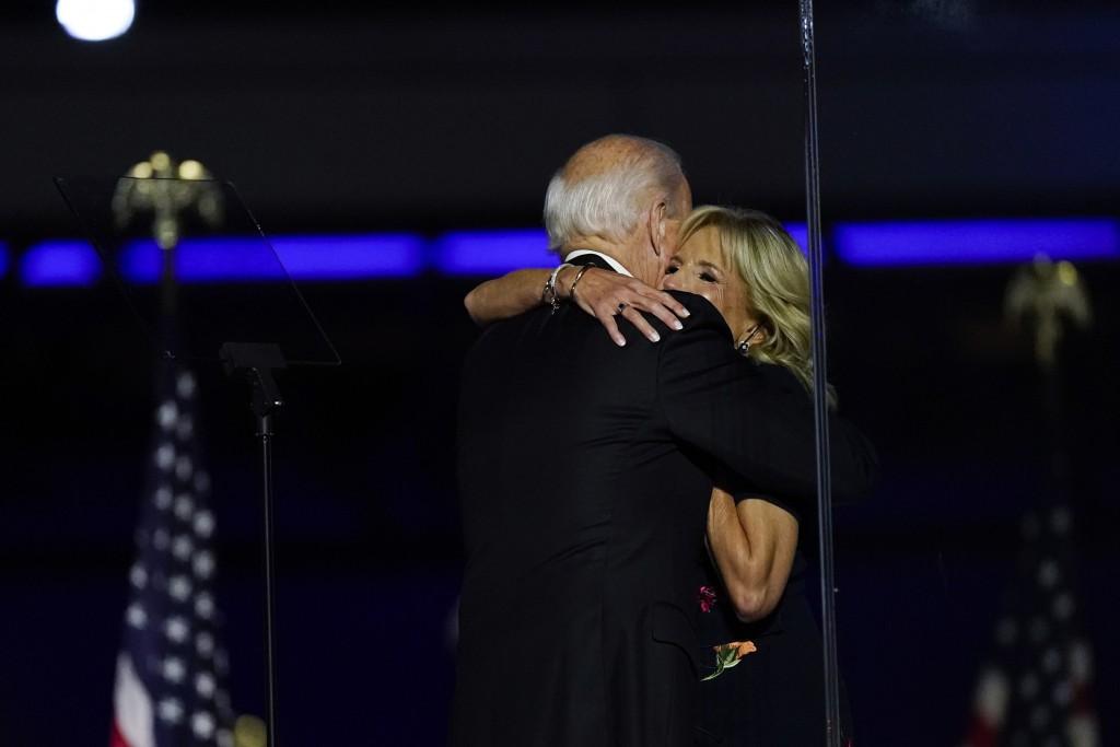 President-elect Joe Biden hugs his wife Jill Biden on stage Saturday, Nov. 7, 2020, in Wilmington, Del. (AP Photo/Andrew Harnik)