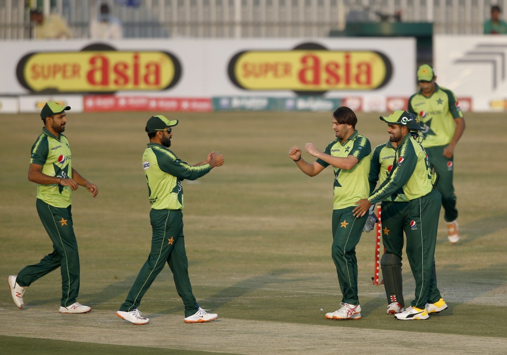 Pakistani spinner Usman Qadir, center, celebrates with teammates after taking the wicket of Zimbabwe's batsman Wessley Madhevere during their 2nd Twen...