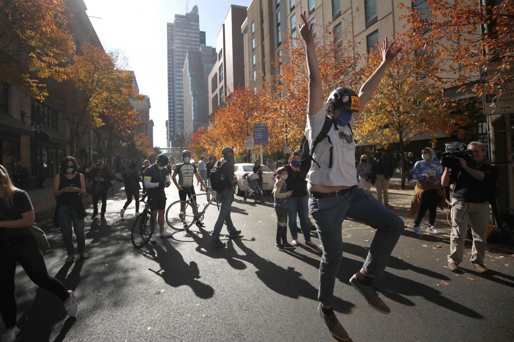 A man celebrates Saturday, Nov. 7, 2020, in Philadelphia, after Democrat Joe Biden defeated President Donald Trump to become 46th president of the Uni...