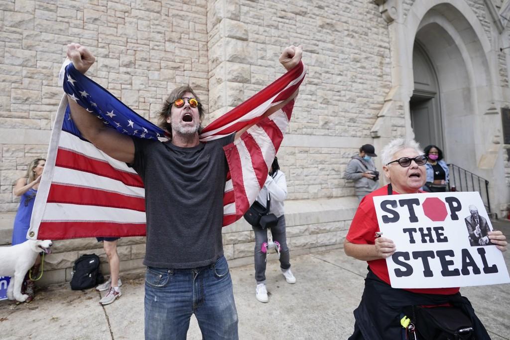 Supporters of President Donald Trump protest near the state capitol, Saturday, Nov. 7, 2020 in Atlanta. Democrat Joe Biden defeated President Donald T...