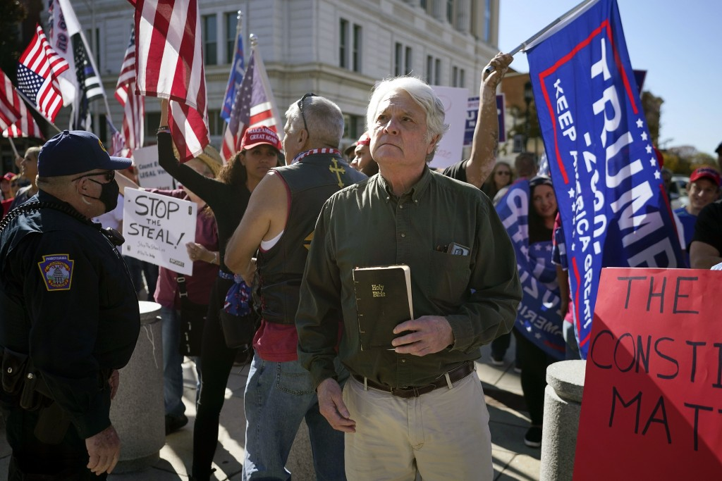 Supporters of President Donald Trump demonstrate outside the Pennsylvania State Capitol, Saturday, Nov. 7, 2020, in Harrisburg, Pa., after Democrat Jo...