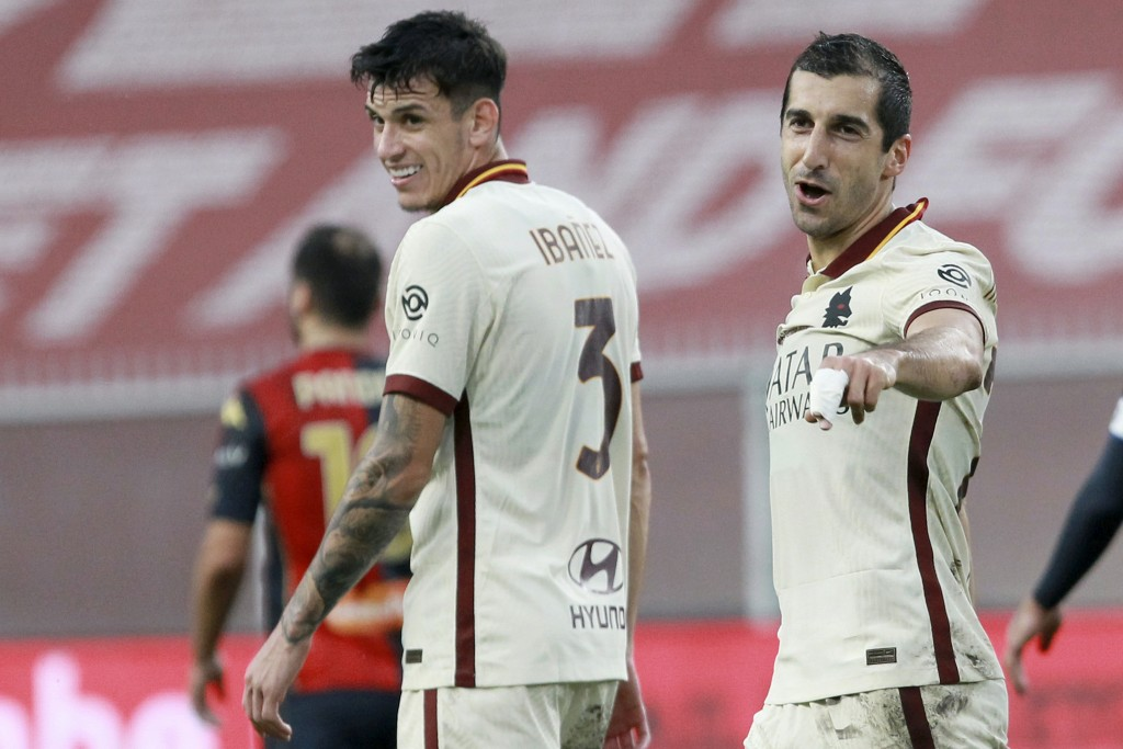 Roma's Henrikh Mkhitaryan, right, celebrates after scoring during the Serie A soccer match between Genoa and Roma, at the Luigi Ferraris Stadium in Ge...