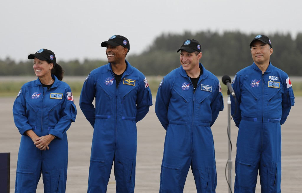 NASA Astronauts from left Shannon Walker, Victor Glover, Michael Hopkins and Japan Aerospace Exploration Agency Astronaut Soichi Noguchi smile during ...