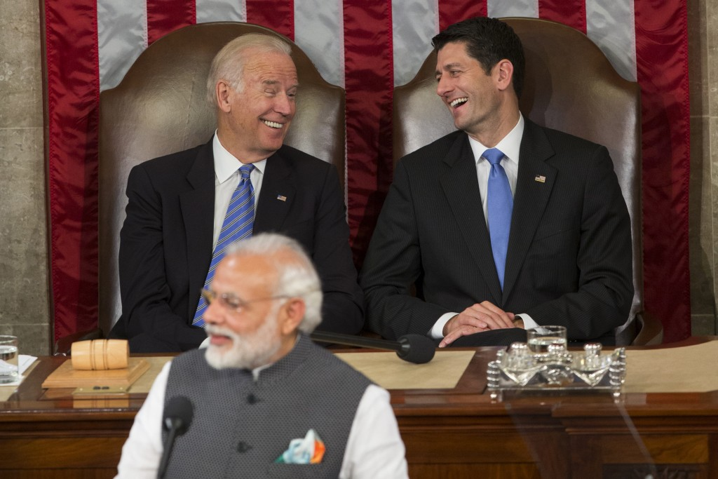 FILE- In this June 8, 2016 file photo, then Vice President Joe Biden and then House Speaker Paul Ryan of Wis., laugh as Indian Prime Minister Narendra...
