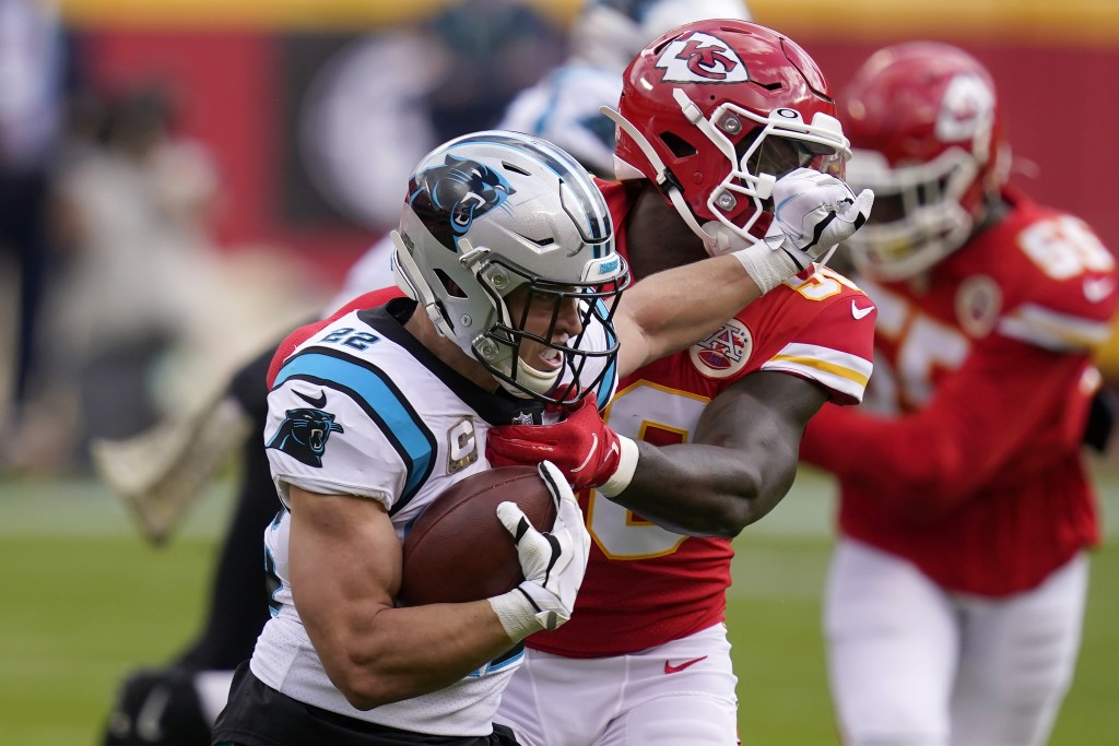 Carolina Panthers running back Christian McCaffrey, left, runs against Kansas City Chiefs linebacker Willie Gay Jr. during the first half of an NFL fo...