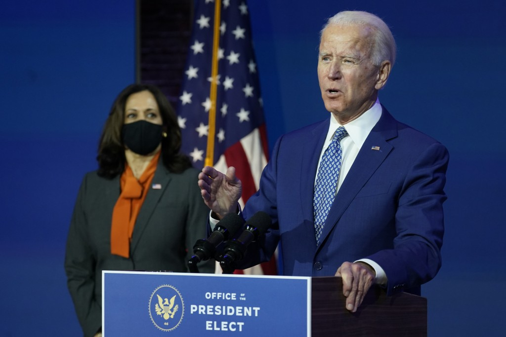 President-elect Joe Biden, joined by Vice President-elect Kamala Harris, speaks at The Queen theater, Monday, Nov. 9, 2020, in Wilmington, Del. (AP Ph...