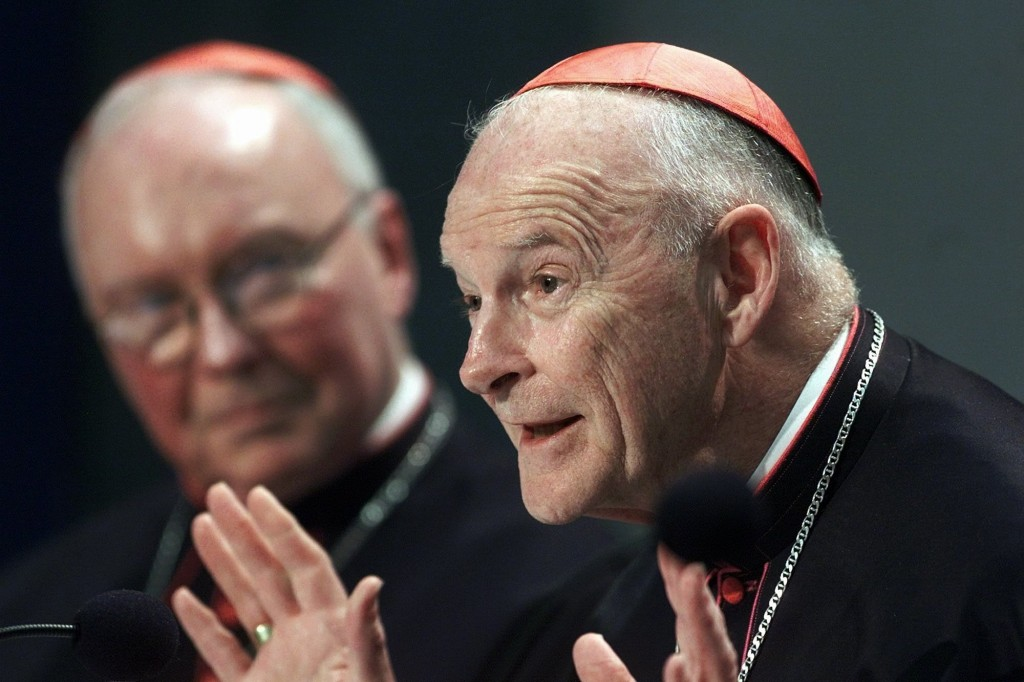 FILE - In this April 24, 2002 file photo, Washington Cardinal Theodore Edgar McCarrick, right, flanked by head of the Pontifical Council for the Laity...