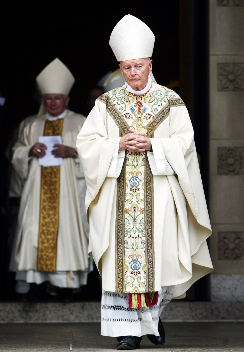 FILE - In this Oct. 30, 2004 file photo, Cardinal Theodore E. McCarrick, leads a procession of priests, bishops and cardinals after a Mass of Christia...