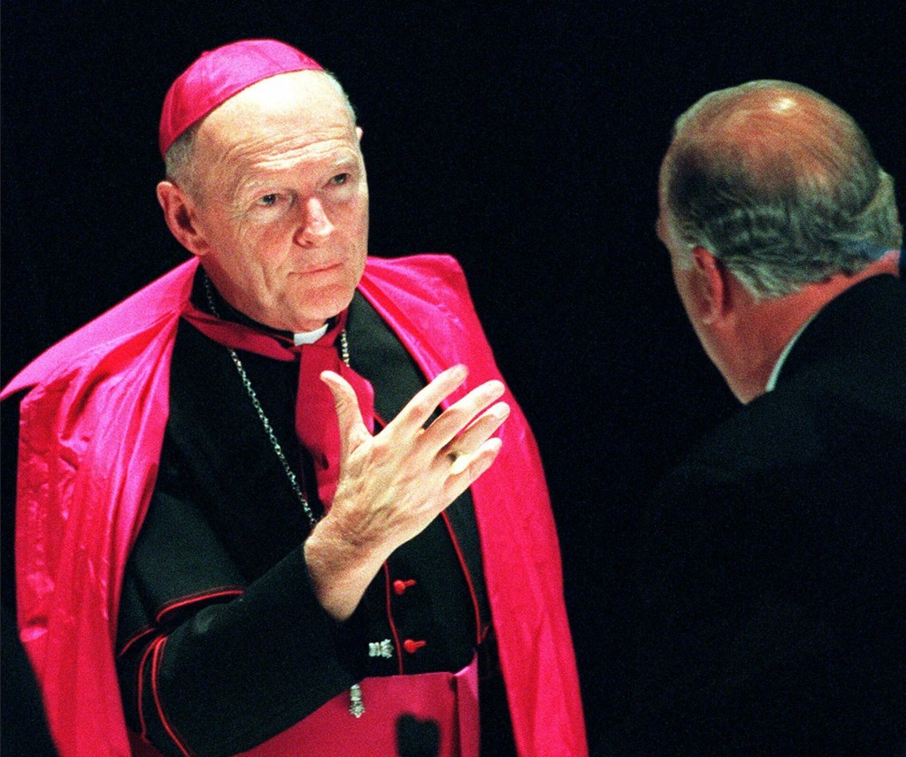 FILE - In this Jan. 15, 2000 file photo, Archbishop Theodore McCarrick, who heads the archdiocese for the U.S. military, speaks with a guest during Ca...