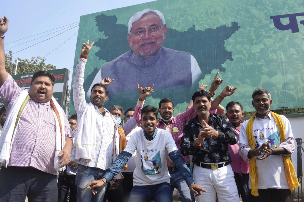 Supporters of Janata Dal (United) celebrate the lead of their party alliance in initial results for the Bihar state assembly polls, in Patna, India, T...