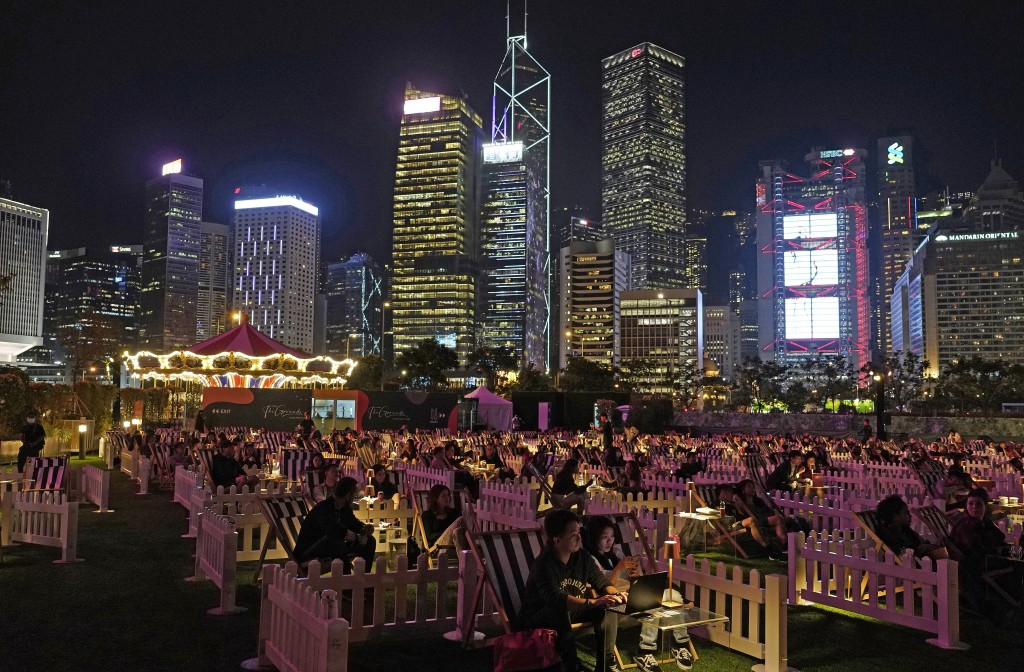 People watch a movie in an outdoor park in Hong Kong Tuesday, Nov. 10, 2020. Hong Kong's first socially-distanced outdoor entertainment park opened it...