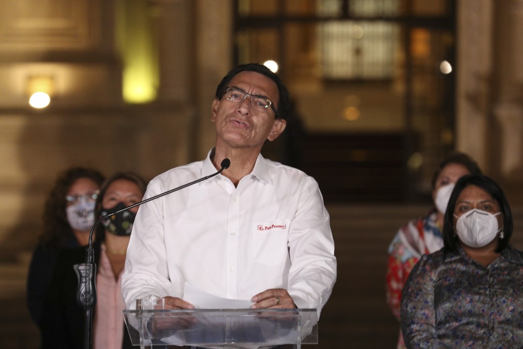Peru's President Martin Vizcarra speaks in front of the presidential palace after lawmakers voted to remove him from office in Lima, Peru, Monday, Nov...
