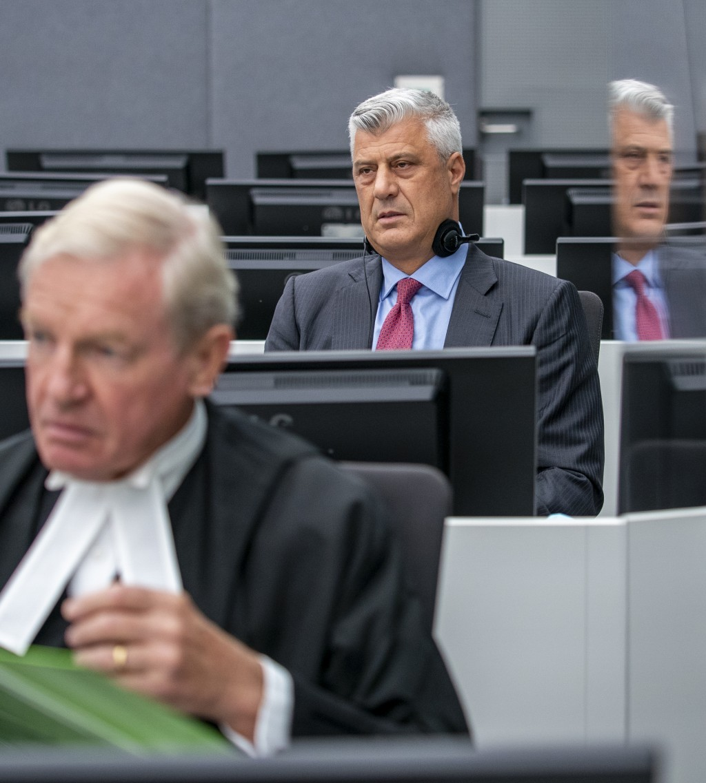 Hashim Thaci, right, who resigned as Kosovo's president to face charges including murder, torture and persecution, and his attorney David Hooper, left...