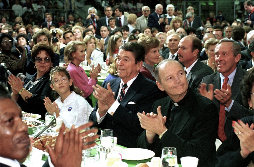 FILE - In this Oct. 12, 1988 file photo, President Ronald Reagan, center, and Newark Archbishop Theodore McCarrick, right, attend a Republican party c...
