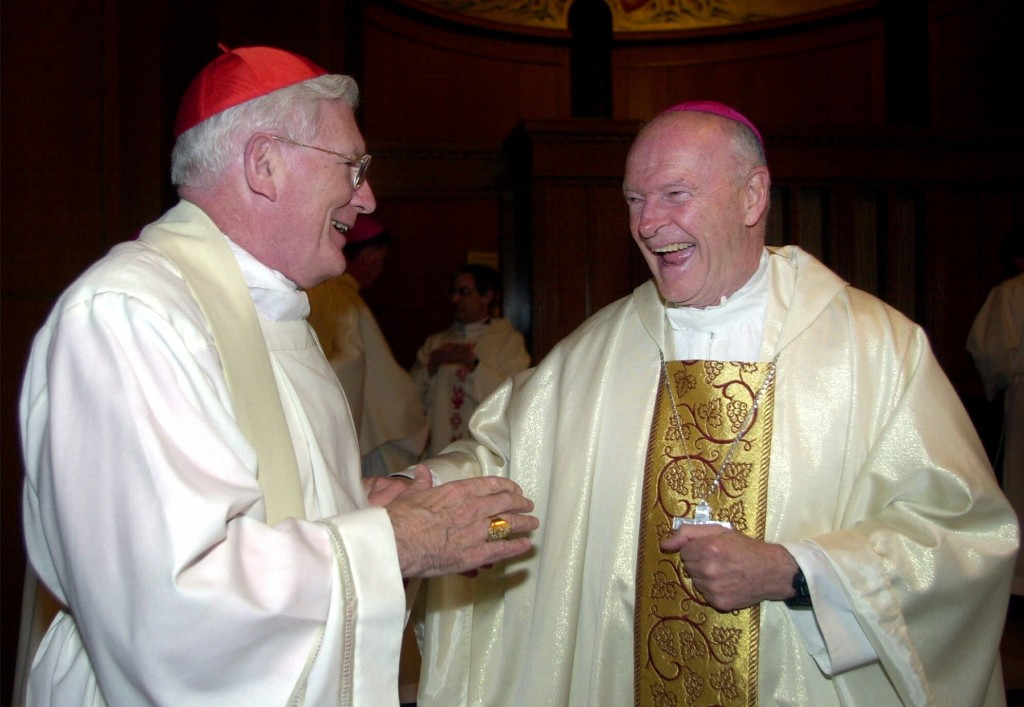 FILE - In this Jan. 21, 2001 file photo, Cardinal-designate Theodore E. McCarrick, right, is congratulated by Cardinal William Keeler of Baltimore bef...