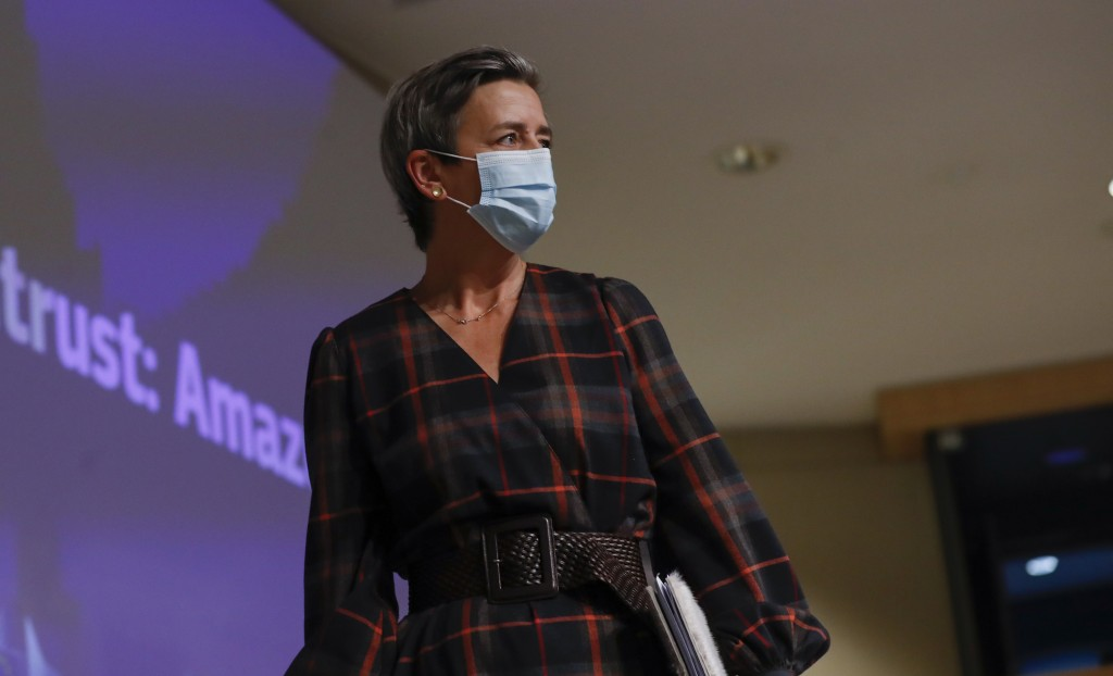 European Executive Vice-President Margrethe Vestager wears a protective face mask after addressing a press conference regarding an antitrust case with...