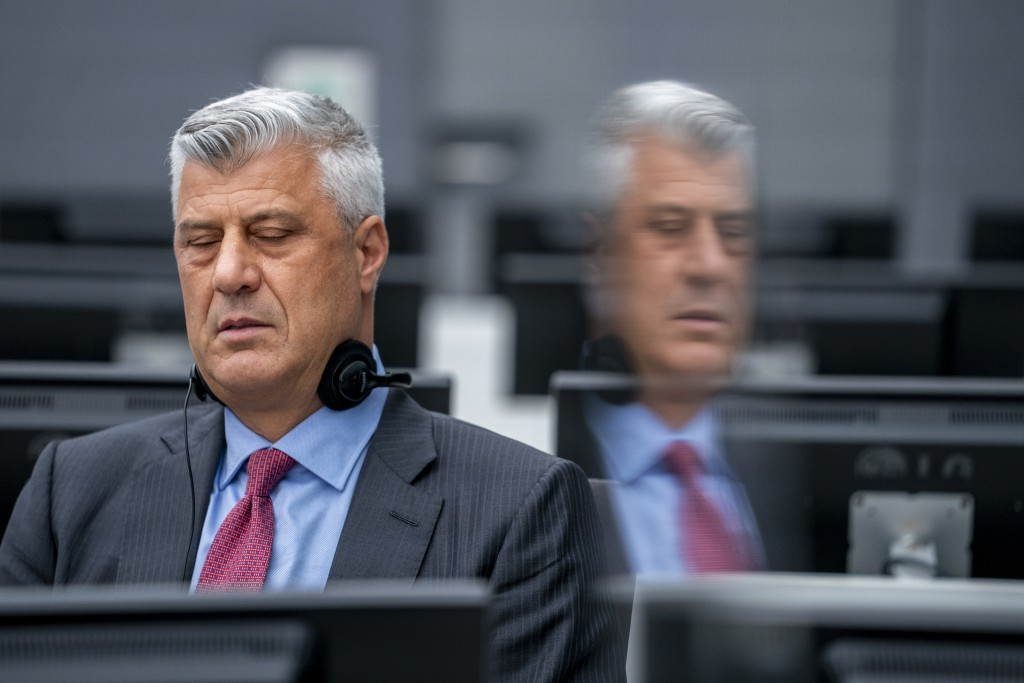 Hashim Thaci who resigned as Kosovo's president to face charges including murder, torture and persecution, and his attorney David Hooper, left, make t...