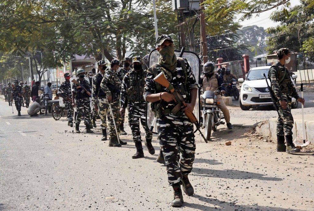 Paramilitary soldiers patrol an area as votes are being counted for the Bihar state assembly polls, in Patna, India, Tuesday, Nov. 10, 2020. (AP Photo...