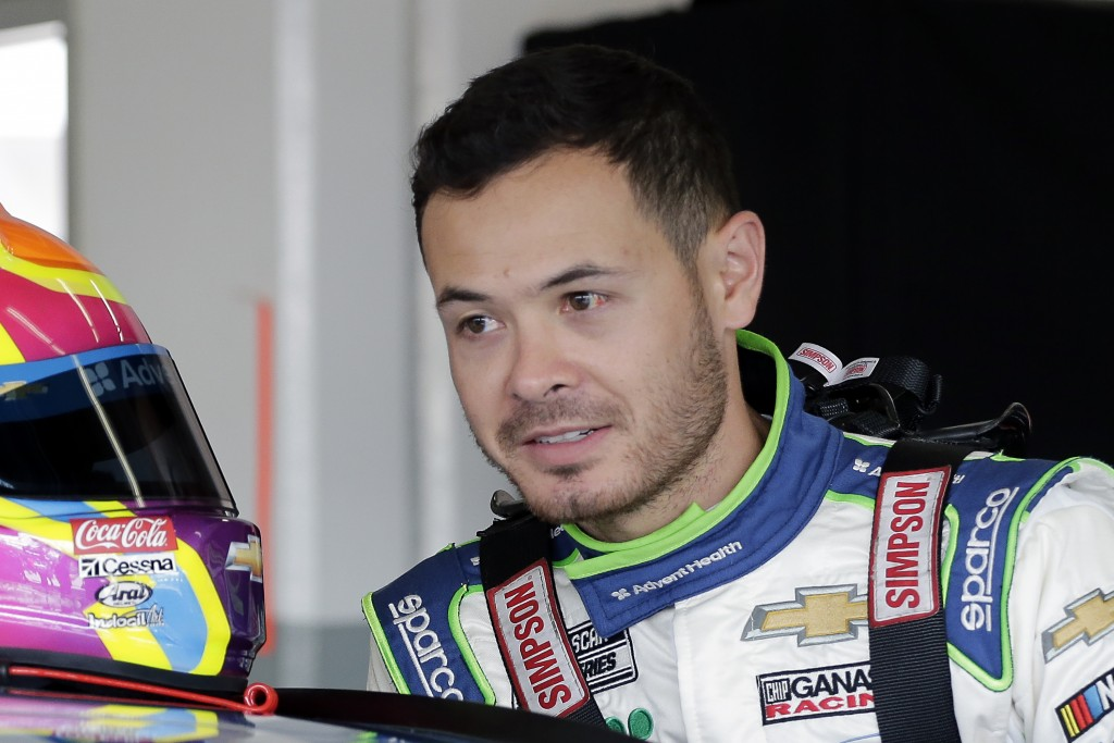 FILE - In this Feb, 8, 2020, file photo, Kyle Larson climbs into his car as he gets ready for a NASCAR auto race practice at Daytona International Spe...