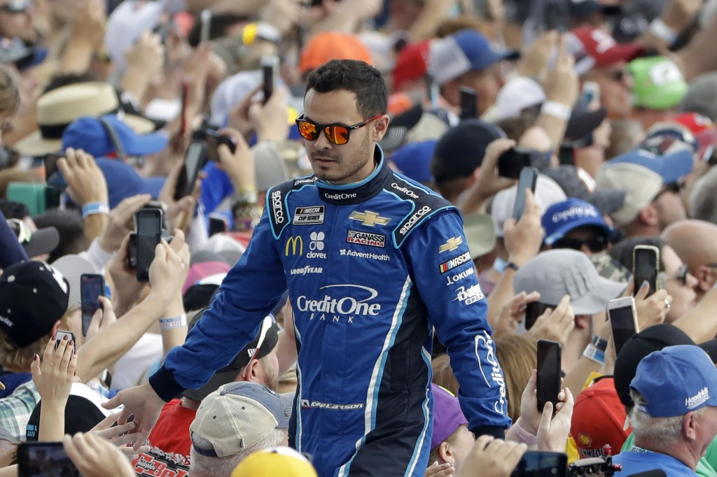 FILE - In this Sunday, Feb. 16, 2020, file photo, Kyle Larson greets fans before the NASCAR Daytona 500 auto race at Daytona International Speedway in...