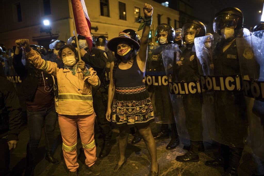 Pro-government protesters gather next to the Congress in Lima, Peru, Monday, Nov. 9, 2020. (AP Photo/Rodrigo Abd)