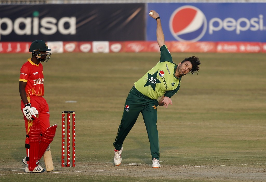 Pakistani spinner Usman Qadir, right, delivers a ball while Zimbabwe's batsman Wessley Madhevere during their 3rd Twenty20 cricket match at the Pindi ...