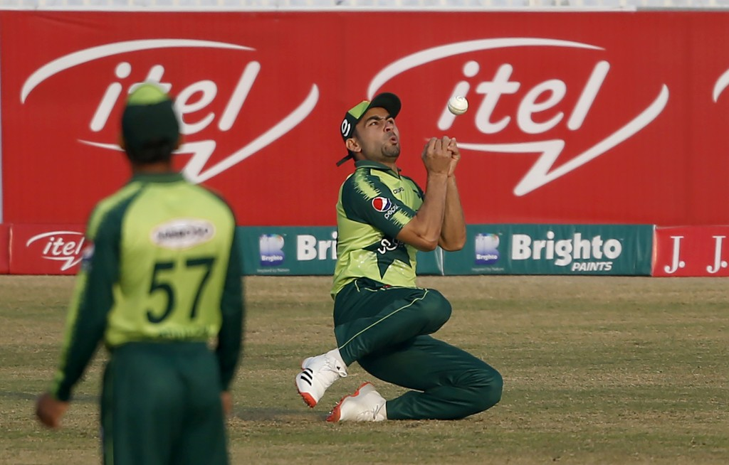 Pakistani fielder Khushdil Shah takes the catch of Zimbabwe's batsman Brendan Taylor during their 3rd Twenty20 cricket match at the Pindi Cricket Stad...