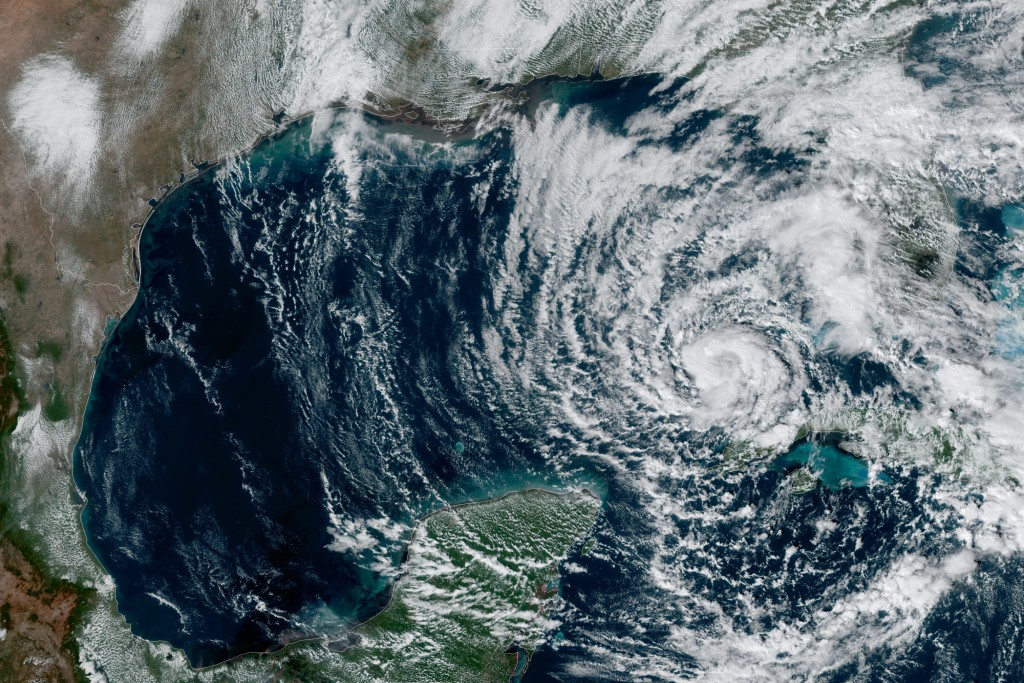 This Monday, Nov. 9, 2020 satellite image made available by NOAA shows Tropical Storm Eta in the Gulf of Mexico at 1:51 p.m. EST. At left is Texas and...