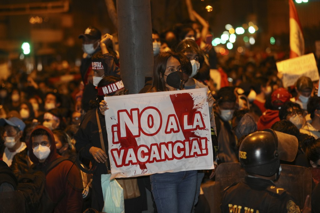 Supporters of President Martin Vizcarra protest the Congress decision to oust him in Lima, Peru, Monday, Nov. 9, 2020. Peruvian lawmakers voted overwh...