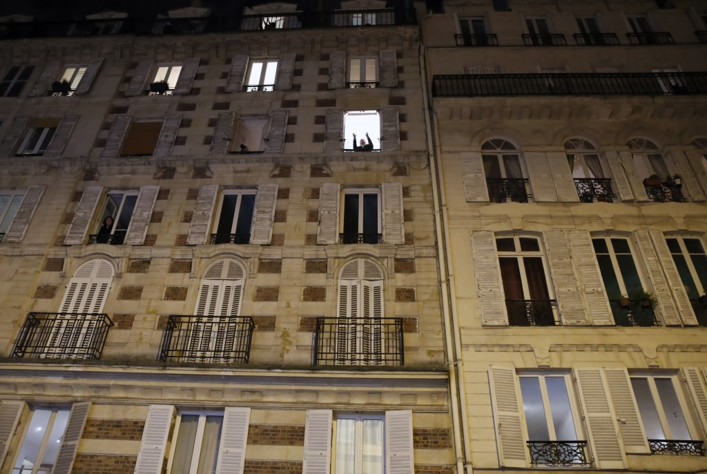 French tenor singer Stephane Senechal sings at dusk, the U.S. national anthem and Tosca of Puccini, from his apartment window during the monthlong par...