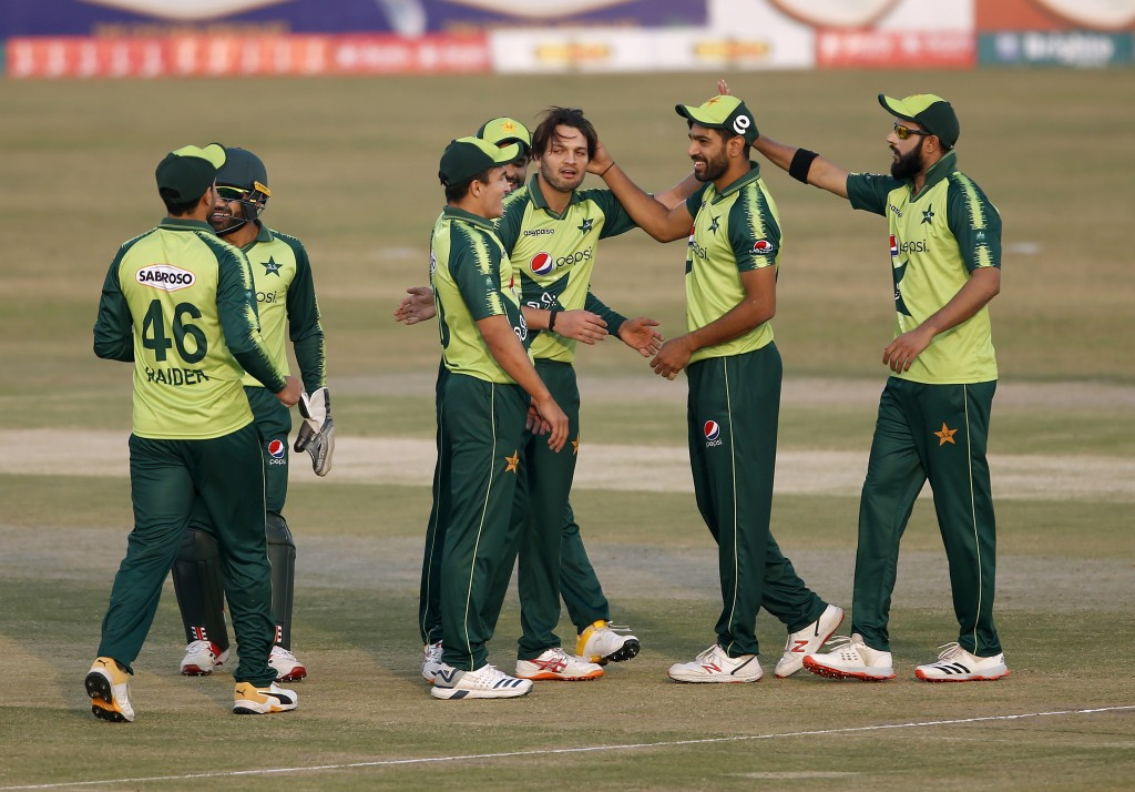 Pakistani spinner Usman Qadir, center, celebrates with teammates after taking the wicket of Zimbabwe's batsman Milton Shumba during their 3rd Twenty20...