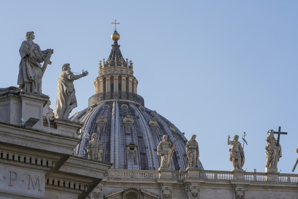 Statues top the facade of St. Peter's Basilica at the Vatican, Tuesday, Nov. 10, 2020. A Vatican investigation into ex-Cardinal Theodore McCarrick has...