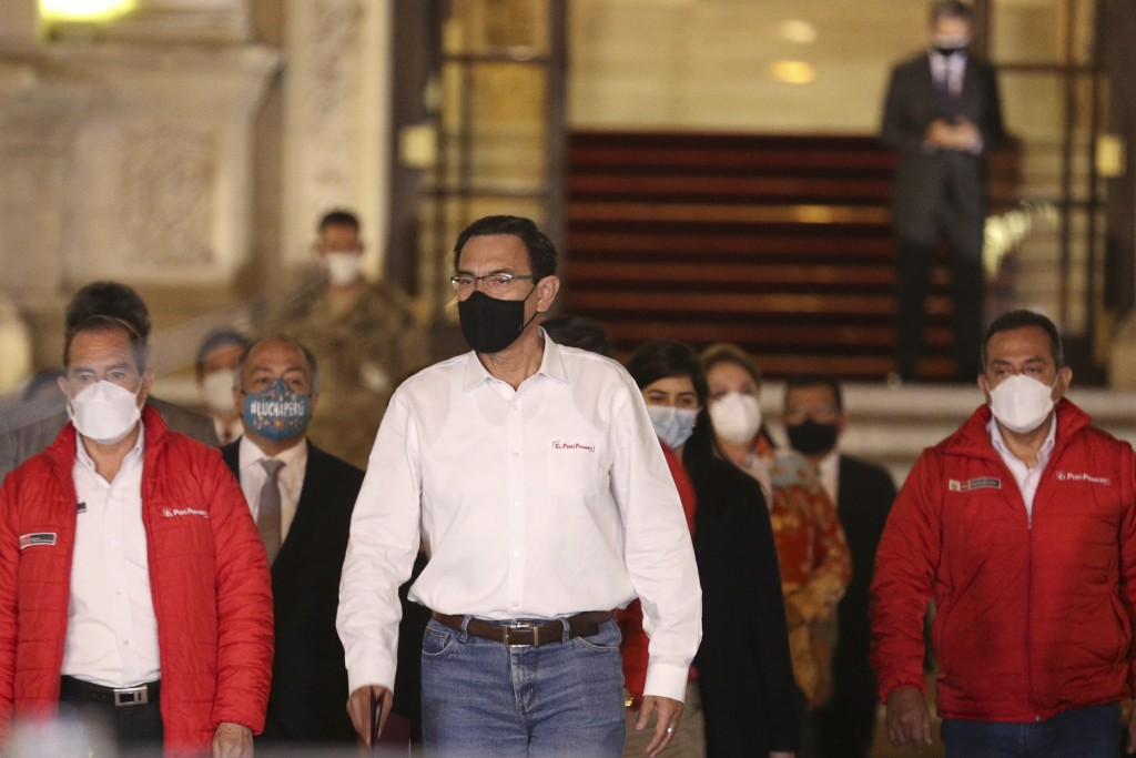Peru's President Martin Vizcarra arrives to read a statement in front of the presidential palace in Lima, Peru, after lawmakers voted to remove him fr...