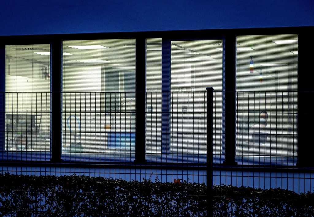 """Two laboratorians work behind jalousies at the headquarters of the German biotechnology company """"BioNTech"""" in Mainz, Germany, Tuesday, Nov.10, 2020. (..."""