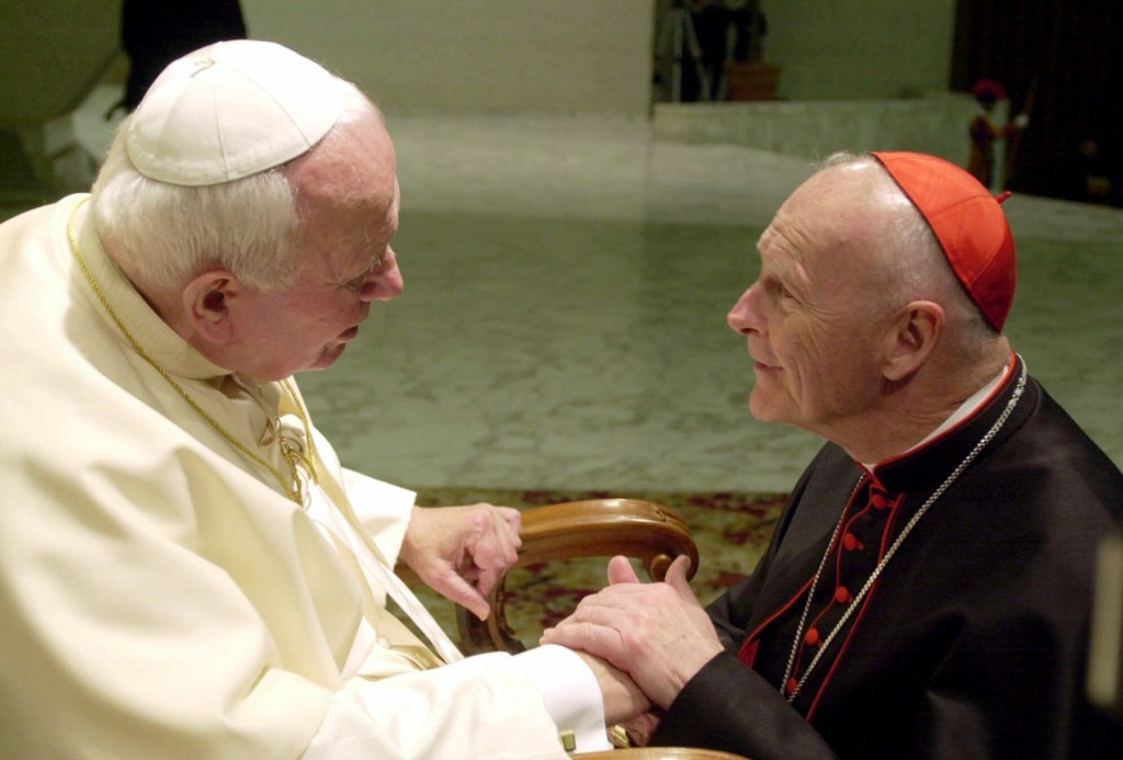 FILE - In this Feb. 23, 2001 file photo, U.S. Cardinal Theodore Edgar McCarrick, archbishop of Washington, D.C., shakes hands with Pope John Paul II d...
