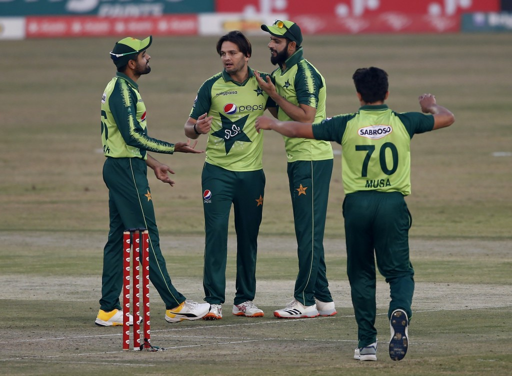 Pakistani spinner Usman Qadir, center, celebrates with teammates after taking the wicket of Zimbabwe's batsman Elton Chigumbura during their 3rd Twent...