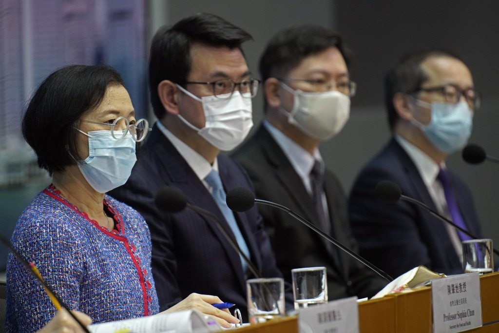 Secretary for Food and Health, Sophia Chan, left, and other officials attend a press conference in Hong Kong Wednesday, Nov. 11, 2020. Hong Kong and S...