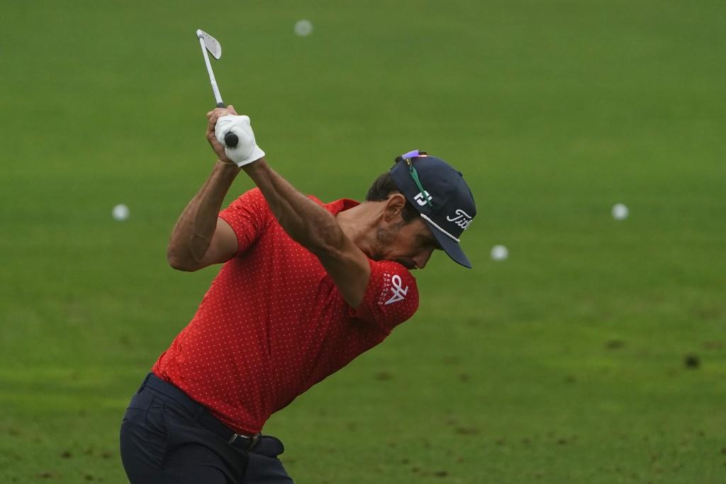 Rafael Cabrera-Bello of Spain, hits at the practice area during the Masters golf tournament Wednesday, Nov. 11, 2020, in Augusta, Ga. (AP Photo/Matt S...