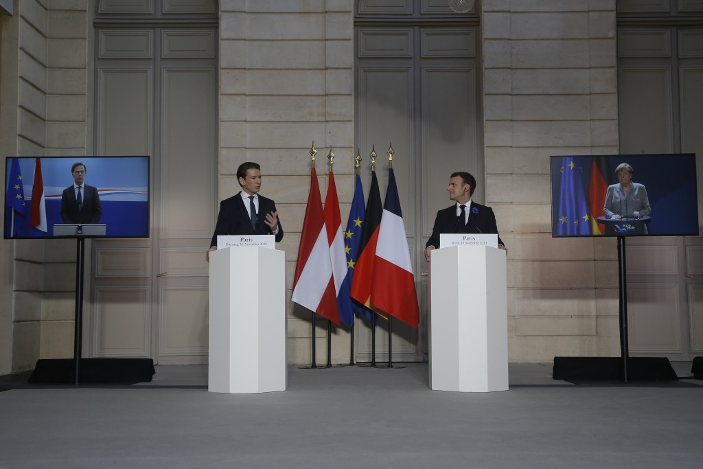 French President Emmanuel Macron, center right, and Austrian Chancellor Sebastian Kurz attend a videoconference with Dutch Prime Minister Mark Rutte, ...
