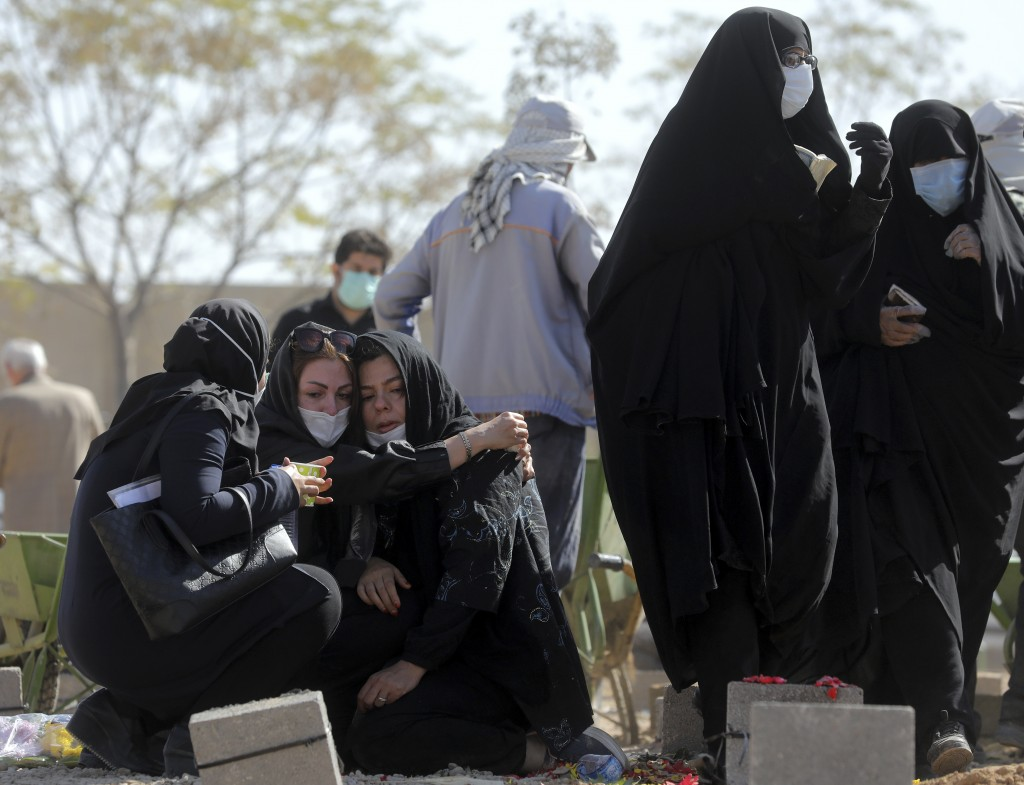 Mourners attend the funeral of a person who died from COVID-19 at the Behesht-e-Zahra cemetery just outside Tehran, Iran, Sunday, Nov. 1, 2020. The ce...