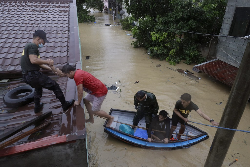 Police rescue residents as floods continue to rise in Marikina, Philippines, due to Typhoon Vamco Thursday, Nov. 12, 2020. A typhoon swelled rivers an...