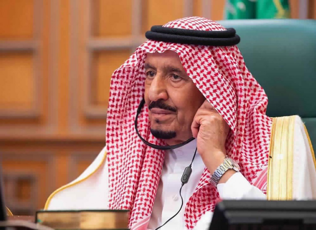 FILE - In this photo released by Saudi Press Agency, SPA, Saudi King Salman, chairs a video call of world leaders from the Group of 20 and other inter...