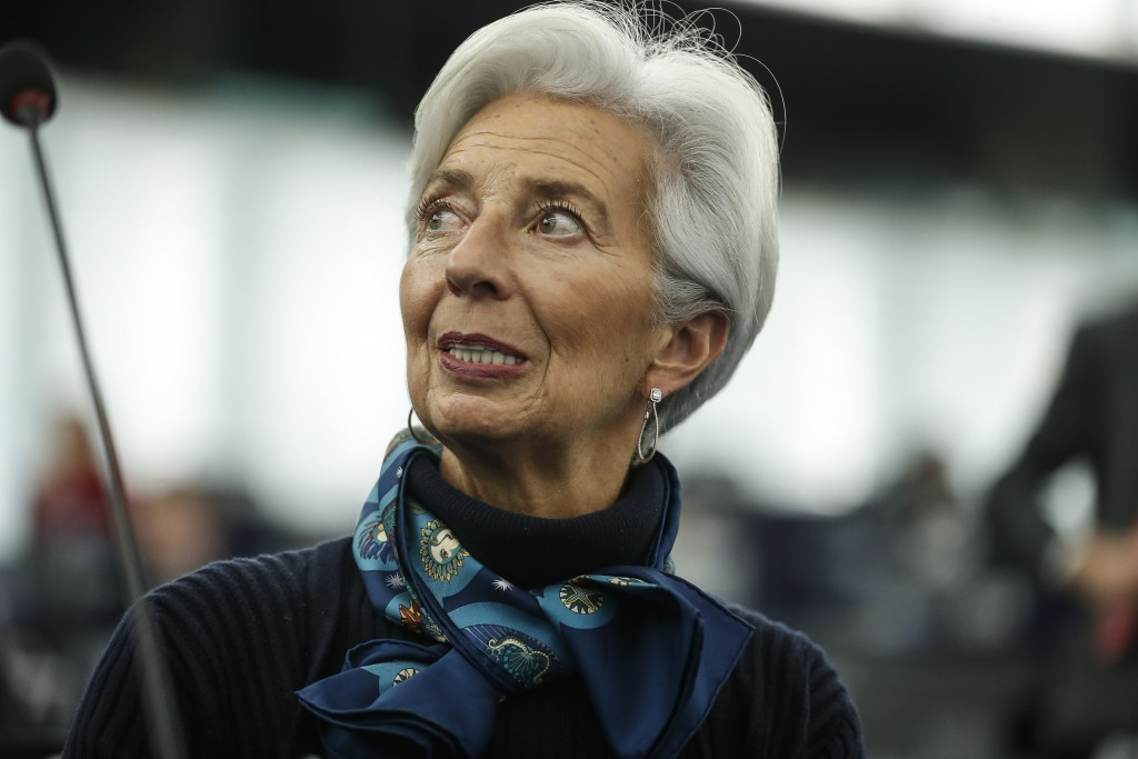 FILE - In this Tuesday Feb. 11, 2020 file photo, Christine Lagarde president of the ECB looks up prior to deliver her speech before the European Parli...