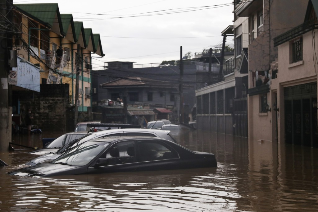Vehicles are seen submerged in flood waters due to heavy rains brought by Typhoon Vamco in Marikina City east of Manila, Philippines, Thursday. Nov. 1...
