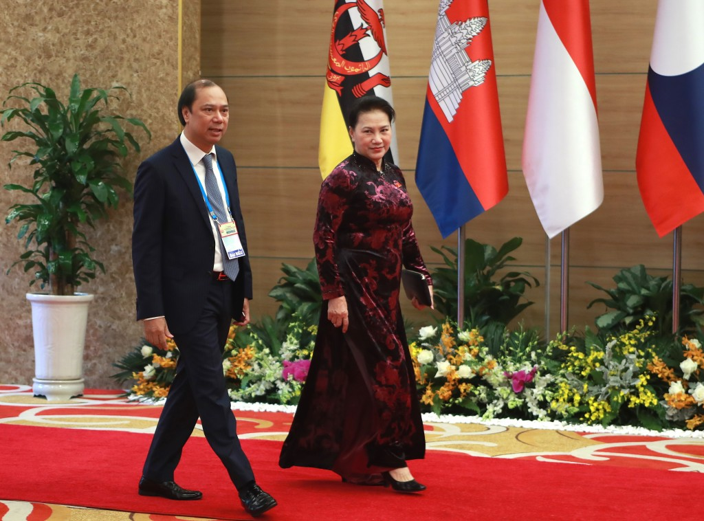 Vietnamese Chairwoman of National Assembly Nguyen Thi Kim Ngan and Deputy Foreign Minister Nguyen Quoc Dung arrive at the venue for the online ASEAN S...