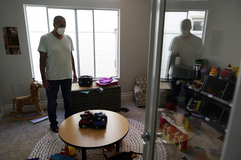 Antonio Gomez stands in his children's play room at home, Wednesday, Nov. 11, 2020, in Simi Valley, Calif. Gomez is recovering at home after a three-w...