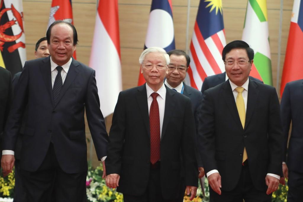 Vietnamese General Secretary Nguyen Phu Trong, center, arrives at venue for the online ASEAN Summit in Hanoi, Vietnam Thursday, Nov. 12, 2020. (AP Pho...