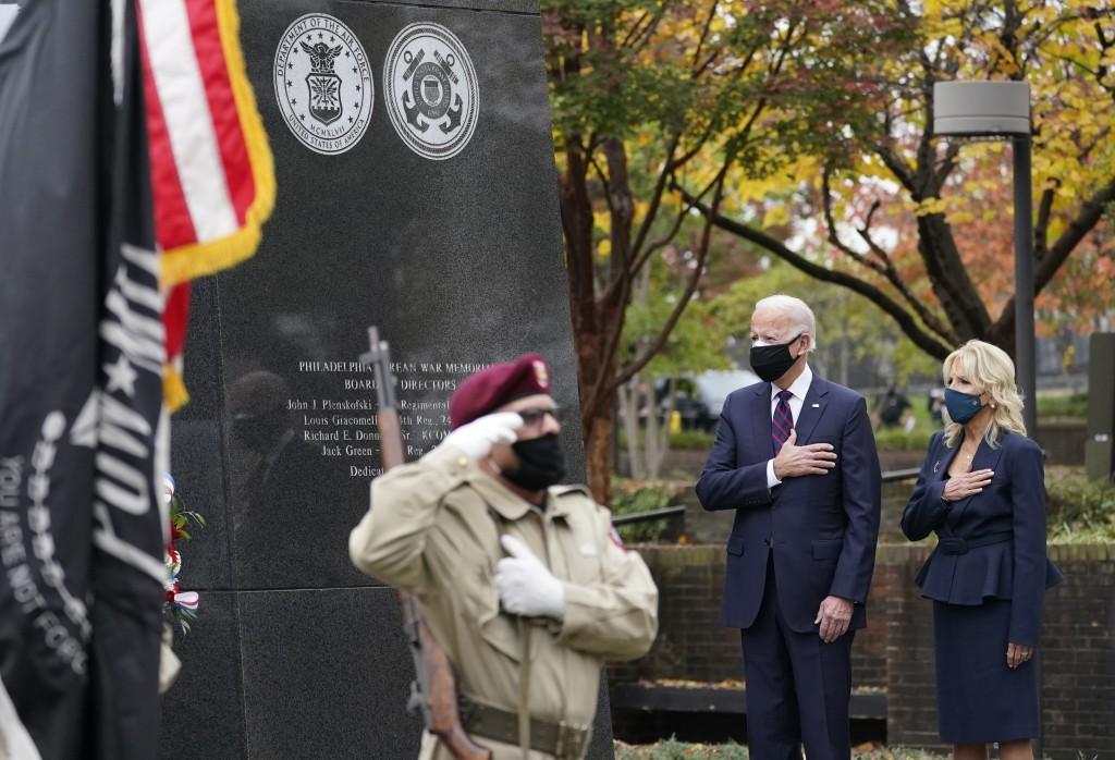 President-elect Joe Biden and Jill Biden, attend a service at the Philadelphia Korean War Memorial at Penn's Landing on Veterans Day, Wednesday, Nov. ...