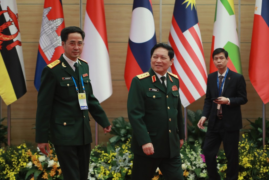 Vietnamese Defense Minister Ngo Xuan Lich, center, arrives at the venue for the online ASEAN Summit in Hanoi, Vietnam on Thursday, Nov. 12, 2020. (AP ...