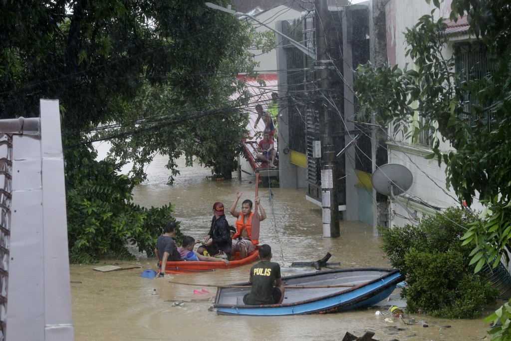 Police rescue residents from their homes as floods continue to rise in Marikina, Philippines, due to Typhoon Vamco on Thursday, Nov. 12, 2020. A typho...